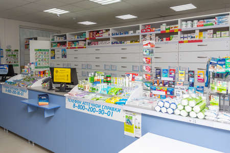 Adygea, Russia - June 6, 2018: counter with a pin pad for payment by credit cards, computers and various goods and medicines in a pharmacy store