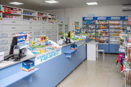 Adygea, Russia - June 6, 2018: a counter with pin pads for credit card payments, computers and various medications in a pharmacy store