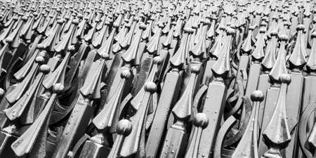 large warehouse of new steel fence sections, black and white photo
