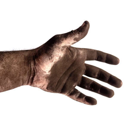 the hand of a male chimney sweep in black soot close up isolated on a white background