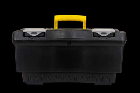 black plastic container tool box isolated on black background close up