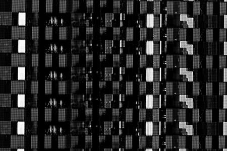 abstract background texture, glitches, digital noise and distortion on the TV screen, black and white photo Stock Photo