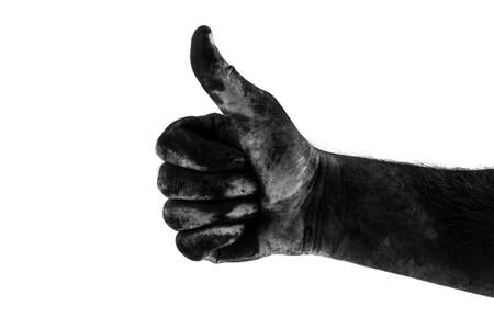 male dirty black hand showing class isolated on white background, black and white photography Banco de Imagens