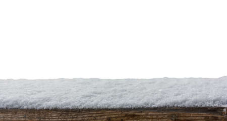 Empty wooden table snow covered with snowfall isolated on white background