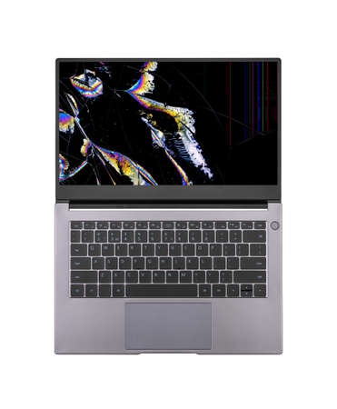 open laptop with a broken screen in color spots and cracks isolated on white background close up top view Stock Photo