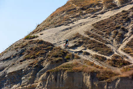 extreme enduro motorcycle driving, a young guy drives down a steep mountain