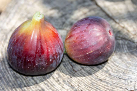 ripe fig berries on a gray wooden background close-up