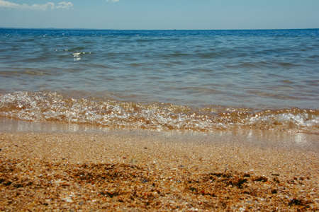 summer landscape with sea waves lapping at the seashore Stock Photo