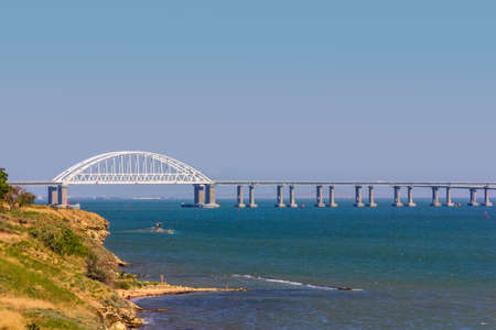 landscape with the black sea coast with a view of the Crimean bridge