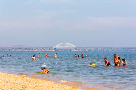 Kerch, Russia - 13 August 2019: vacationing tourists swim in the Black sea on a warm summer day