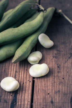 Broad Beans on a wooden Table photo