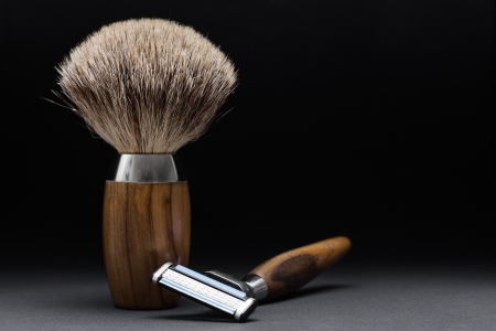 Shaving Tool on wooden Table and black Background photo