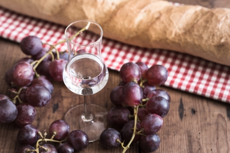 italien Grappa with Grape and Bread