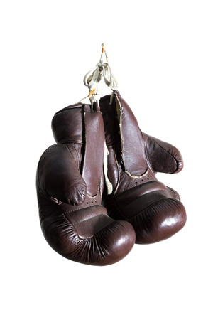 old Boxing Gloves, hanging, isolated on white Background photo