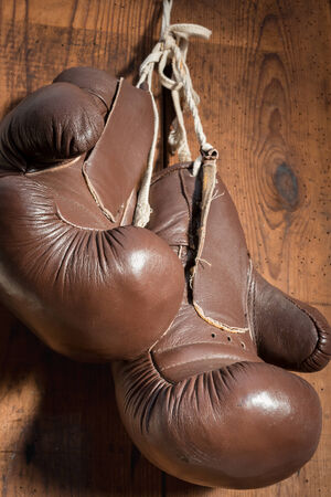 old Boxing Gloves, hanging on wooden wall photo