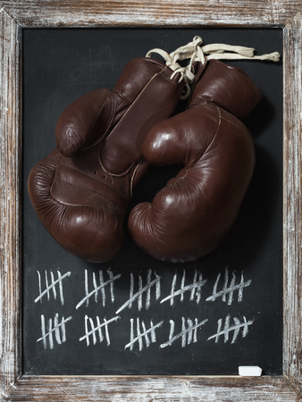 tally: old Boxing Gloves on Chalkboard with Tally Sheet Stock Photo