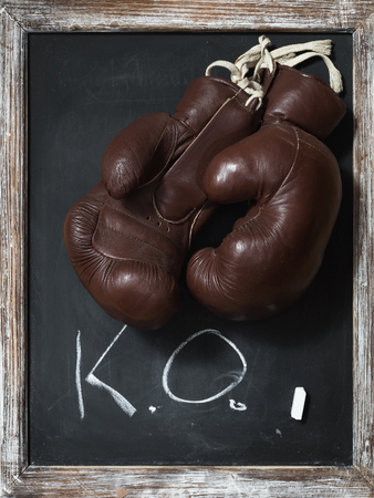 old Boxing Gloves on Chalkboard with Text K.O. photo