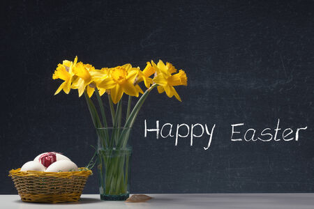 Happy Easter - Daffodil in a Glass with Eggs and a little Gift photo