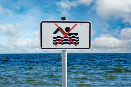 underestimate: bathing prohibition sign on the Baltic Sea