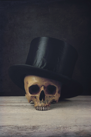topper: Vanitas with Skull and Topper Hat on wood Stock Photo