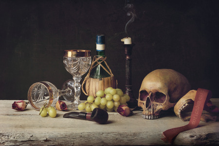 Vanitas witch Skull; Pipe, wine glass, wine and grape photo