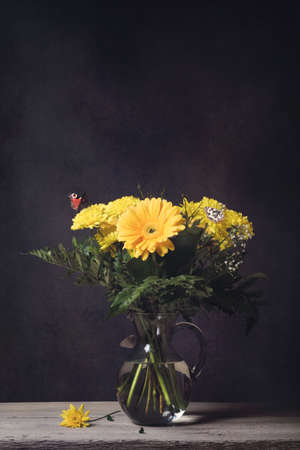 ringlet: Bouquet of flowers on a table with butterflies and fly Stock Photo