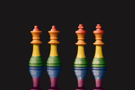 sex discrimination: Kings and queens pawns symbolizing the same sex marriage