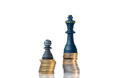 Chess pieces on a stack of coins in the Colors of Greece and the EU photo