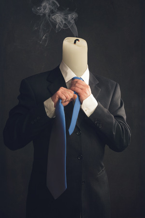 burn out: Symbol of a businessman with burn out syndrome Stock Photo