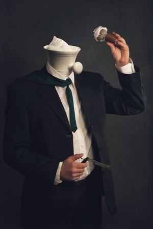 depilate: a headless Man in Suit with Razor, Brush and Shaving Bowl