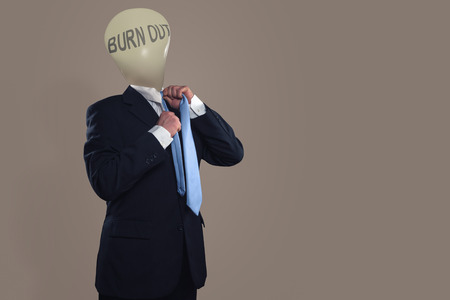 burn out: Symbol of a headless businessman with burn out syndrome