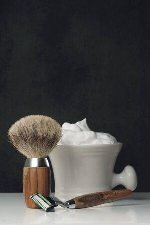 body grooming: vintage wet Shaving Equipment on white Table