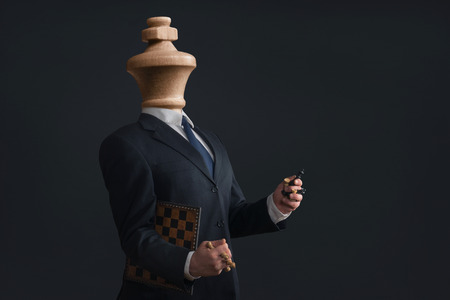 selfish: Symbol of a Headless Narcissist with pawns in the hands Stock Photo