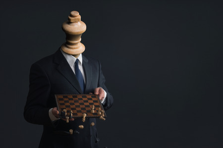 Symbol of a headless businessman who fires his staff Stock Photo