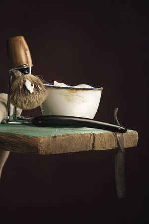 depilate: vintage Shaving Tool on wooden Table and dark Background Stock Photo