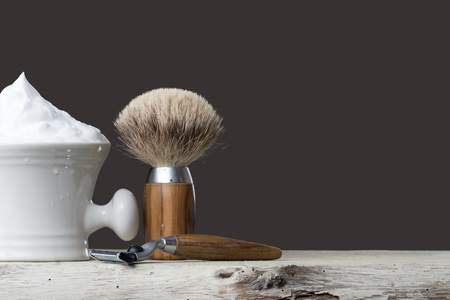 depilate: vintage Shaving Tool on wooden Table and gray Background Stock Photo