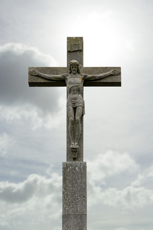 golgotha: crucifix with Jesus Christ before cloudy sky Stock Photo