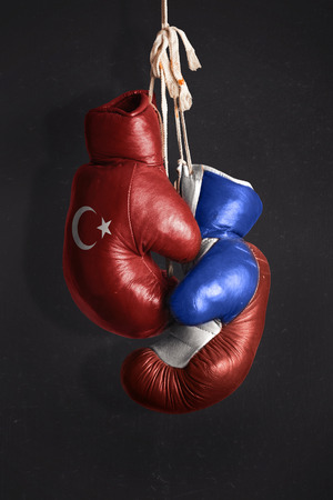 ceasefire: Symbol of the Crisis between Turkey and Russia symbolized with Boxing Gloves Stock Photo