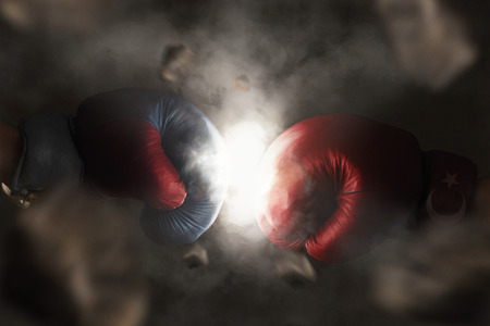 war: Symbol of the Crisis between Turkey and Russia symbolized with Boxing Gloves Stock Photo