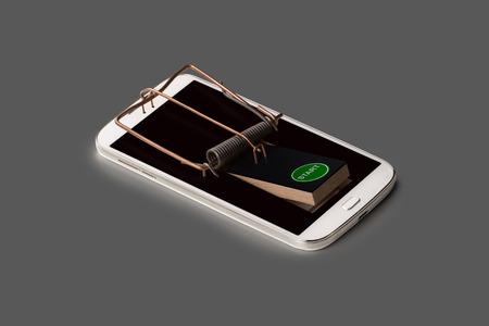 gatillo: Un smartphone simb�licamente como una trampa para ratones con el gatillo Foto de archivo