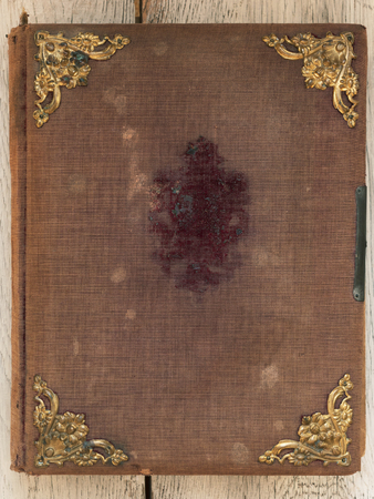 Old vintage book cover with golden ornaments