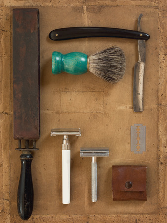 depilate: Flat Lay of Shaving Equipment on vintage Backdrop