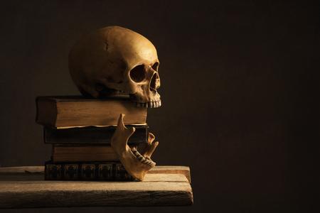 jawbone: Human Skull with Jawbone on old Books