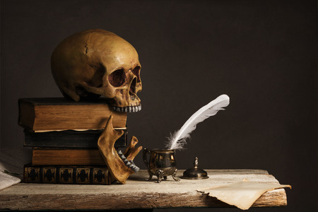 inkpot: Skull on old Books with empty Page, Feather and Inkpot