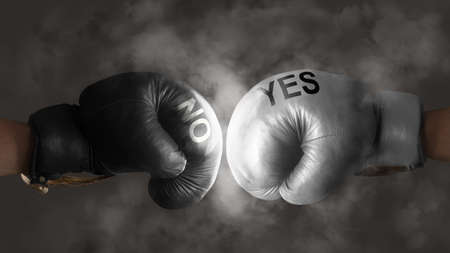 symbolize: Two boxing gloves symbolize the struggle for a decision Stock Photo