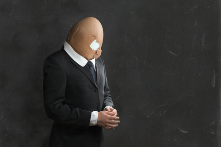 burned out: Businessman with broken Egghead and Suit