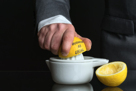 destructive: Concept for business as usual with Lemon and a Man Stock Photo