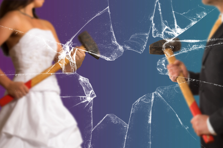 Couple with with Sledgehammer behind a broken Glass Pane