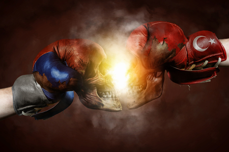 annihilate: Symbol of the Crisis between Turkey and Russia symbolized with Boxing Gloves Stock Photo