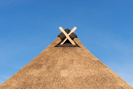 Thatched Roof with Gable Decoration in Lower Saxony Stock Photo